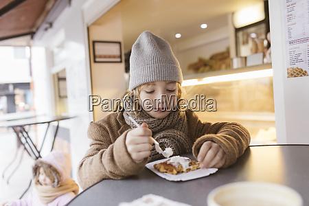 belgium portrait of boy eating belgian