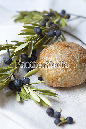 an olive roll with olive branches