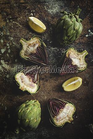 fresh artichokes over grunge background