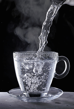 boiling water being poured into a