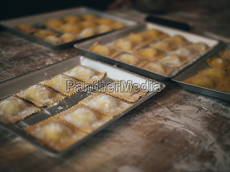 prepared ravioli in pans