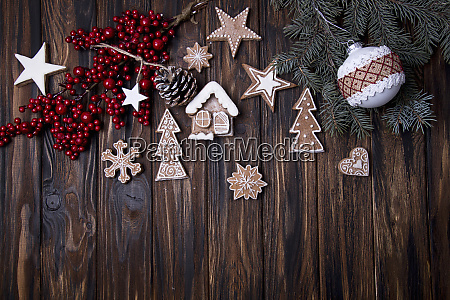 christmas wooden background with branch of
