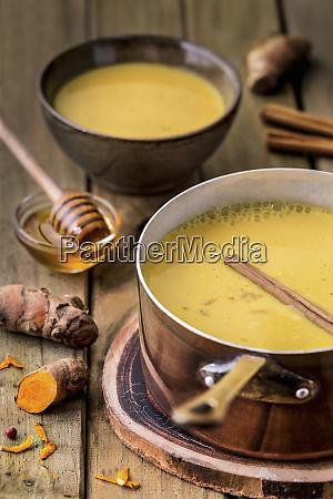 appetizing yellow kurkuma soup with honey