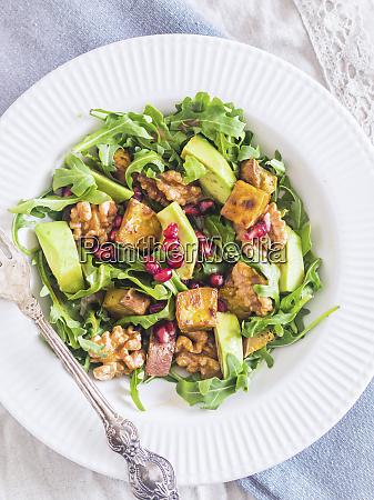 arugula salad with sweet potatoes avocado