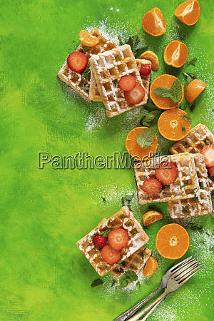 waffles with strawberries and oranges