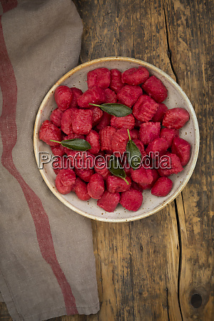 homemade beetroot gnocchi in bowl