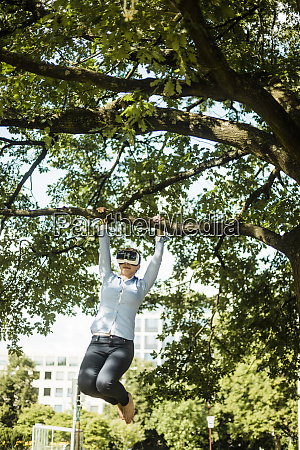 woman in urban park hanging at