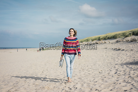 mature woman walking barefoot on the