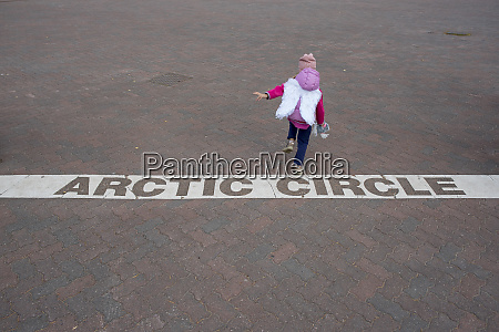 finland rovaniemi girl crossing the arctic