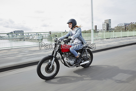 germany cologne young woman riding motorcycle