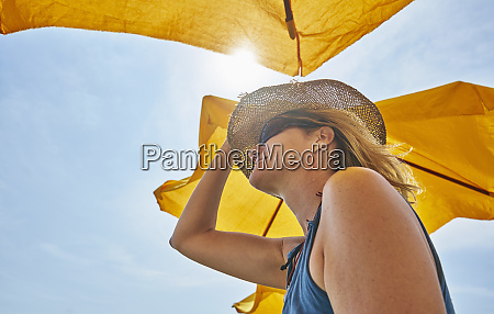 smiling woman wearing straw hat under