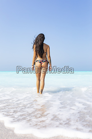 young woman standing at the sea