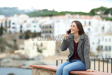 happy woman talking on phone on