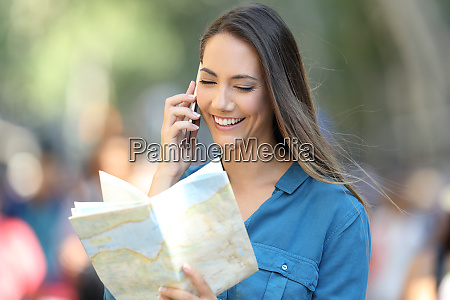 happy tourist asking information on phone