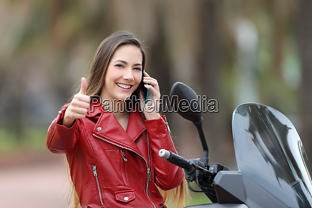 happy biker with thumbs up on