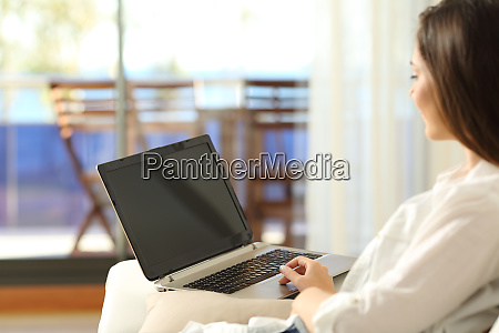 woman using a laptop with blank