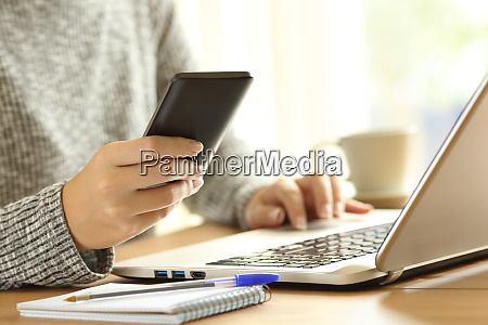woman using a phone and a