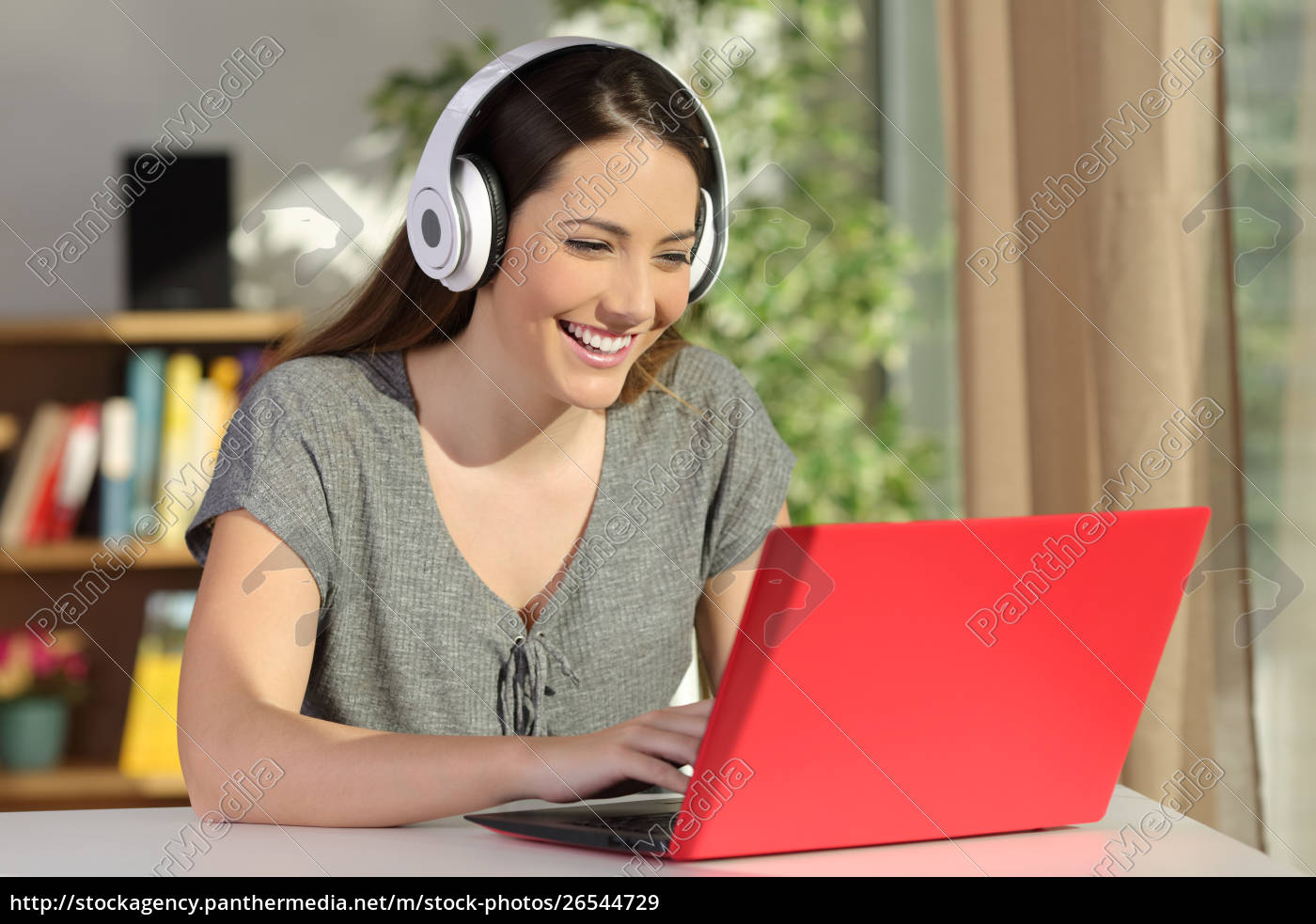 Girl E Learning With A Laptop And Headphones At Home Royalty Free Image 26544729 Panthermedia Stock Agency