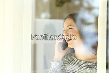 girl talking on phone beside a