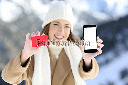 woman showing a card and phone
