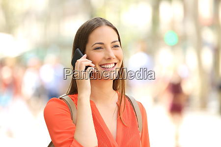 woman walking and talking on phone