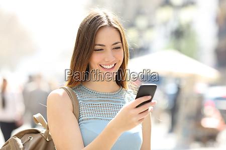 happy girl walking in the street