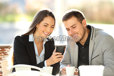 two executives watching on line content