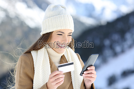 woman paying on line in winter
