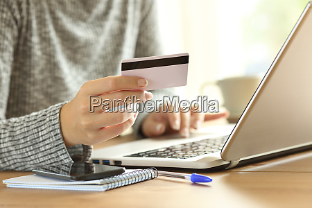 woman hand paying on line with