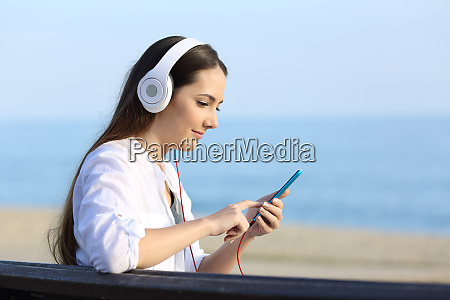 girl listening to music and choosing