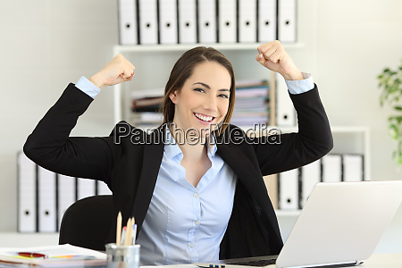 motivated businesswoman looking at camera at