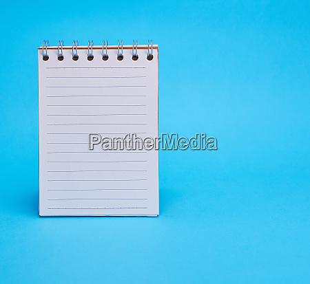 open blank notebook in line on