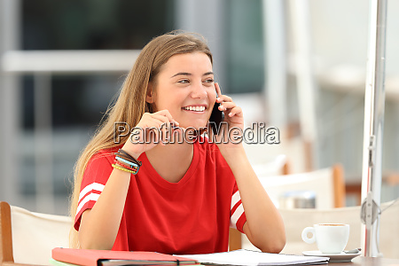 candid student girl talking on phone