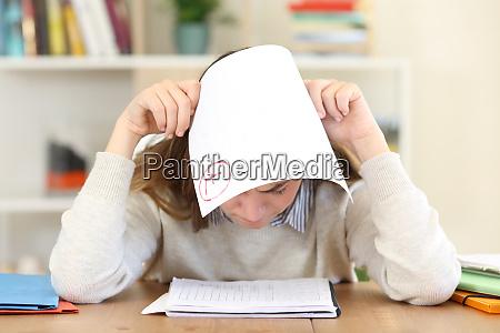 sad student with a failed exam