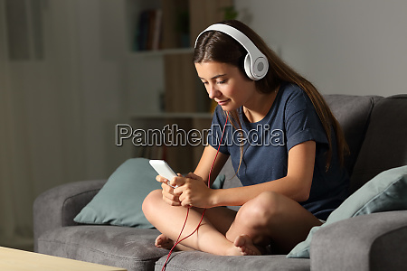teen listening to music at home