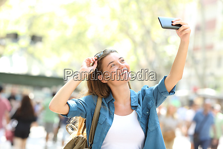 fashion girl taking selfies in the