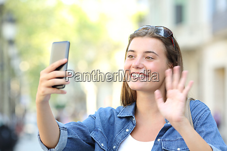 girl waving hand during a phone