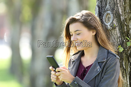 happy teen using a smart phone