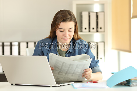 young trainee reading a newspaper at