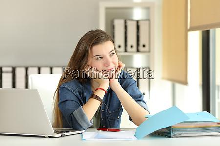 intern dreaming at office looking at