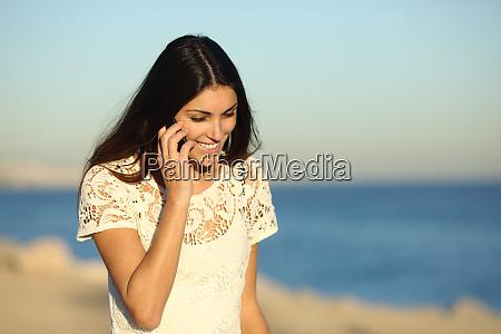 happy woman talking on phone walking