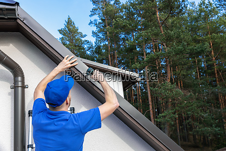 roofer installing metal drip edge profile