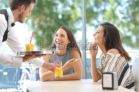 friends meeting in a bar with