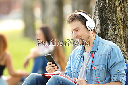 student learning listening audio tutorials in