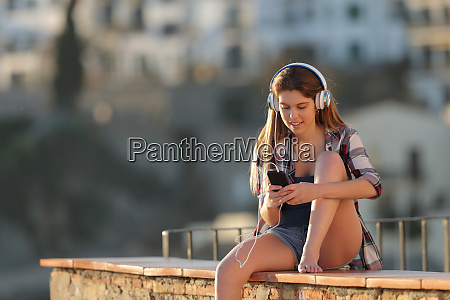 happy teen listening to music from