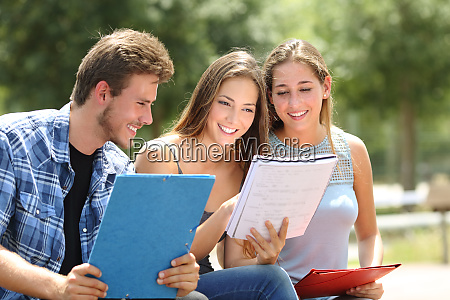 three students studying together in a