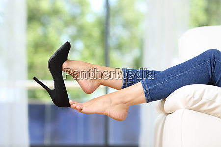 woman feet taking off shoes resting