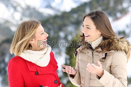 two women talking in winter holiday