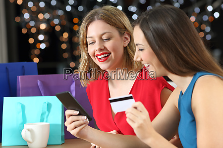 two shoppers shopping on line with