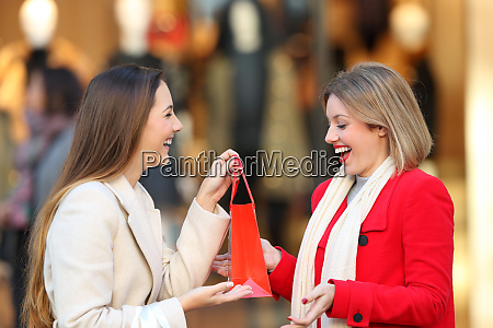 smiley shopper giving a gift to